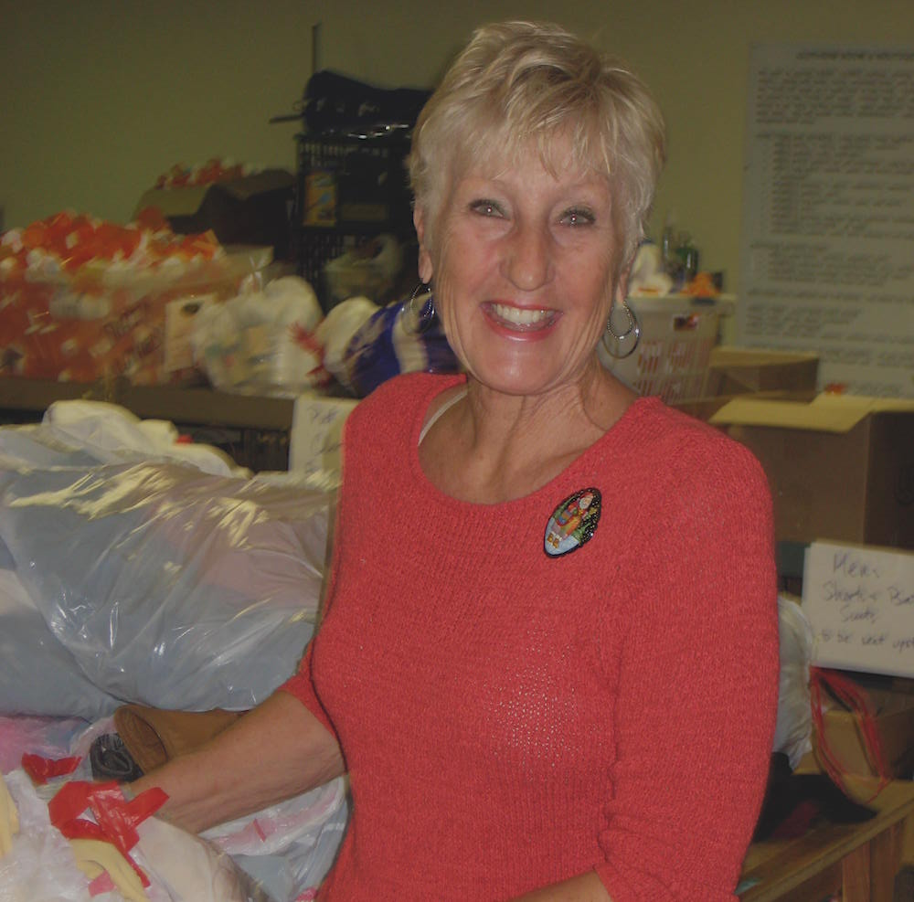Volunteer Helping with Clothing