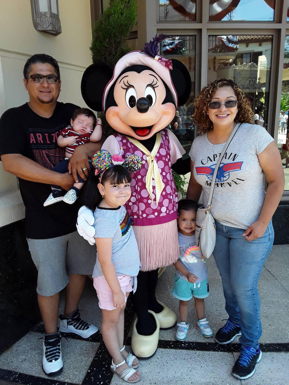Anabel and her family at Disney Land with Mini Mouse